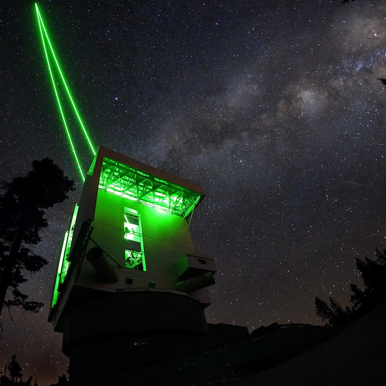 Large Binocular Telescope with the green ARGOS laser guide star system active.